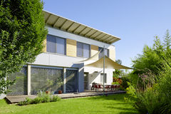 Modern house with garden. Modern, stylish house with a beautiful garden Stock Image