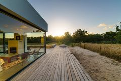 Modern house with garden swimming pool and wooden deck Royalty Free Stock Images