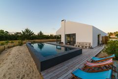 Modern house with garden swimming pool and wooden deck Stock Image