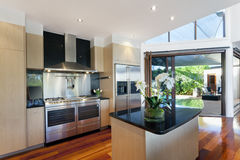 Modern house interior. Dining area and kitchen in stylish Australian home Stock Images