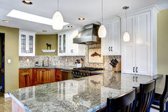 Modern house interior. Kitchen room with shiny granite tops and. Modern house interior. White and brown kitchen room with shiny granite tops and mosaic royalty free stock photo