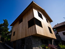 Modern house in Italian Alps. Modern designed house in Italian Alps Royalty Free Stock Photography