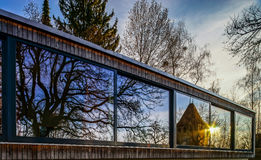 Modern house with long glass wall, mirror glazing, sunset. Fribourg, Swiss stock images