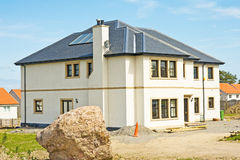 Modern house nearing completion. Royalty Free Stock Photos