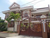 Modern house new home luxury on jepara. Beauty modern house new home luxury for medium family. It`s european style on brown color Stock Photo