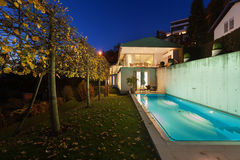 Modern house by night stock photography