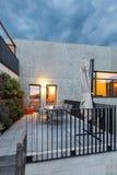 Modern house outdoor. External of a modern house with veranda, evening scene Stock Image