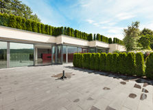 Modern house, outdoor. Modern house with garden, external, view from patio Stock Photography