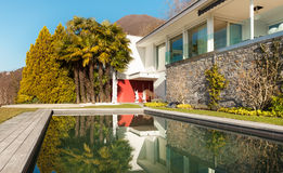 Modern house, outdoor. Modern house with swimming pool, outdoor Royalty Free Stock Images