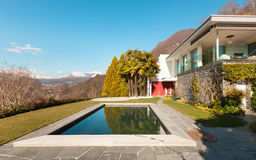Modern house, outdoor. Modern house with swimming pool, outdoor Royalty Free Stock Image