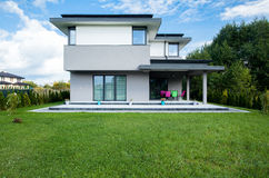 Modern house. Photo of the new modern house with big garden royalty free stock image