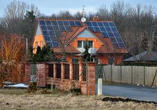 Modern house and photovoltaic panel stock photography