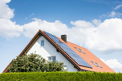 Modern House with Photovoltaic System Royalty Free Stock Photos
