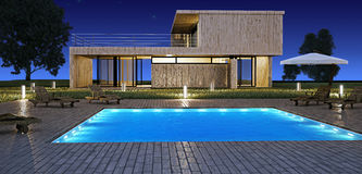 Modern house with pool. Modern house with swimming pool in night vision Stock Photos