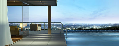 Modern house with pool. And a beautiful view over the city at evening Royalty Free Stock Photo