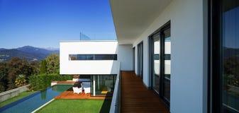Modern house, with pool. Modern house with pool and garden, summer time Royalty Free Stock Photo