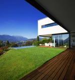 Modern house, with pool. Modern house with pool and garden, summer time Stock Photography