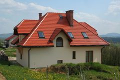 Modern house with red roof. House with red roof, village Stock Photos