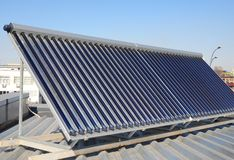 Modern House Roof with Solar Water Heater, Solar Panels as energy efficiency solution. Vacuum solar water heating system Stock Photography