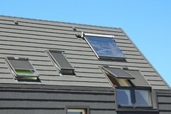 Modern House Roof with Solar Water Heater, Solar Panels and Skylights, Beautiful New Contemporary House with Solar Panels. Royalty Free Stock Photography