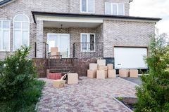 Modern house with stacks of cardboard boxes. For moving royalty free stock photo