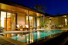 Modern house with swimming pool. In nature Royalty Free Stock Photos