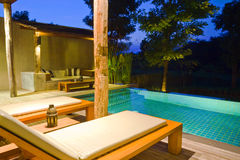 Modern house with swimming pool. In nature Royalty Free Stock Images