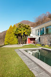 Modern house with swimming pool Stock Photos
