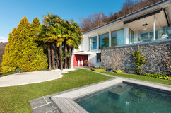 Modern house with swimming pool Royalty Free Stock Image