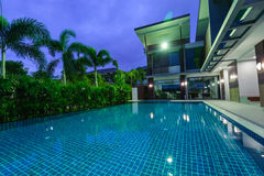 Modern house with swimming pool at night Royalty Free Stock Images