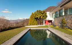 Modern house with swimming pool Royalty Free Stock Images