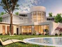 Modern house with swimming pool. Modern white house with swimming pool royalty free stock image