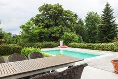Modern house, veranda and pool Stock Images