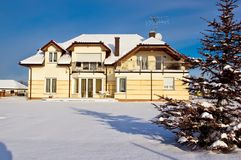 Modern house in winter Royalty Free Stock Photos