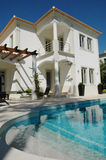 Modern House With Blue Pool And Terrace - Holidays Stock Images