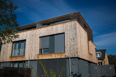 Modern house, with wooden cladding - wooden facade, Royalty Free Stock Photo