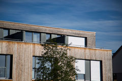 Modern house, with wooden cladding - wooden facade, wooden house, Stock Photo