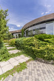 Modern housefront surrounded by plants Royalty Free Stock Photos