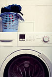 Modern household washing machine and a pile of dirty laundry Stock Photo