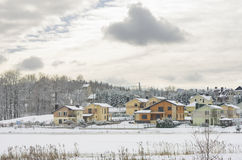 Modern houses by  the frozen lake in winter Royalty Free Stock Image