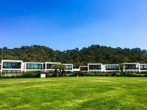 Modern houses green grass stock photos
