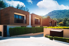 Modern houses with green plant wall. Actual eco architecture Stock Photography