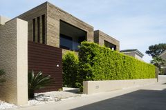 Modern houses with green plant wall. Actual eco architecture Stock Image