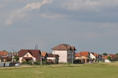 Modern houses. Houses with blue sky on the background Royalty Free Stock Image