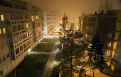 Modern houses at midnight. Modern houses in foggy night at midnight royalty free stock photo