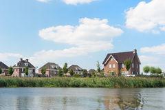Modern houses near river Stock Photography