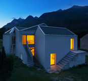 Modern houses by night Stock Photos
