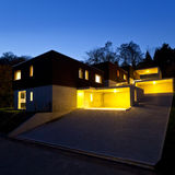Modern houses, outdoor by night Stock Images