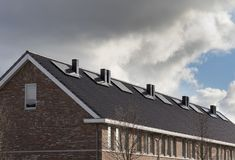 Modern houses with solar panels, black solar panels royalty free stock photo