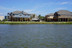 Modern houses on stilts. Located on Galveston Bay off the Texas Gulf Coast, these houses are elevated to limit flood damage during tidal surges and hurricanes Royalty Free Stock Photo